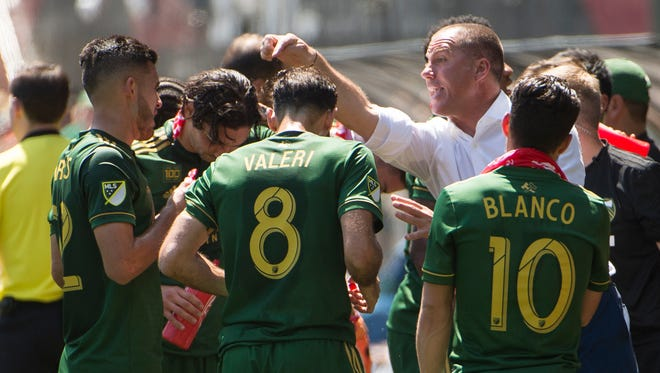 May 13, 2018; Portland, OR, USA; Portland Timbers head coach Giovanni Savarese instructs his players during a water break against the Seattle Sounders at Providence Park. The Timbers won 1-0.