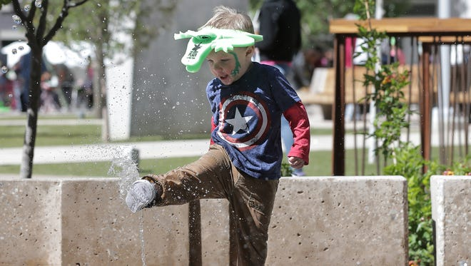 Joey Gudenrath, 2, plays in the splash pad at San Jacinto Plaza recently.