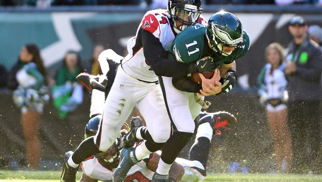 Philadelphia Eagles quarterback Carson Wentz (11) is sacked by Atlanta Falcons outside linebacker Vic Beasley (44) during the first half at Lincoln Financial Field.