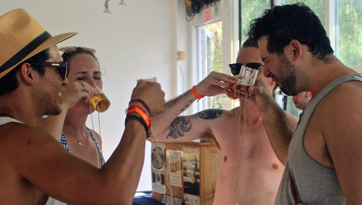 A group of friends taste different beer flavors crafted