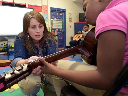 Jennifer Partridge teaches fourth-grader JaLaya Terrell