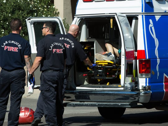 Las Cruces Fire and EMS tend to a man Wednesday October