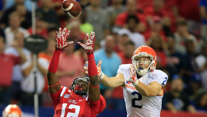 Ole Miss junior Tony Conner (left) will be out for the team's bowl game.