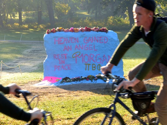 Pi Beta Phi sorority members painted The Rock on the MSU campus in memory of their sorority sister Morgan McGregor who died on Saturday.