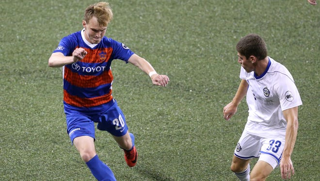 FC Cincinnati midfielder Jimmy McLaughlin (20) makes a move on Charlotte Independence defender Donnie Smith (33) in the second half of a USL match between Charlotte Independence and FC Cincinnati, Wednesday, July 18, 2018, at Nippert Stadium in Cincinnati. FC Cincinnati won 2-0.