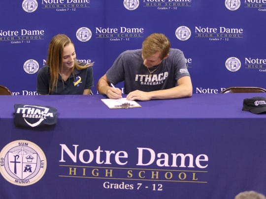 Notre Dame senior Matt Smith signs to play baseball at Ithaca College during a ceremony May 17 at Notre Dame High School.