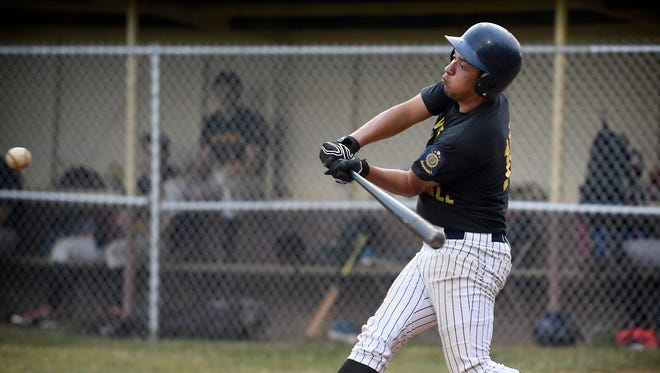 5th Ward's Andy Ortiz swings during a 5-4, extra-innings win Thursday over Annville.