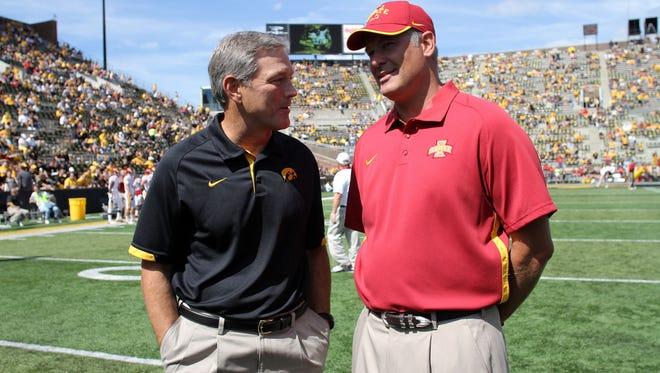 Iowa head coach Kirk Ferentz chats with Iowa State head coach Paul Rhoads prior to their game at Kinnick Stadium on Saturday, Sept. 8, 2012.