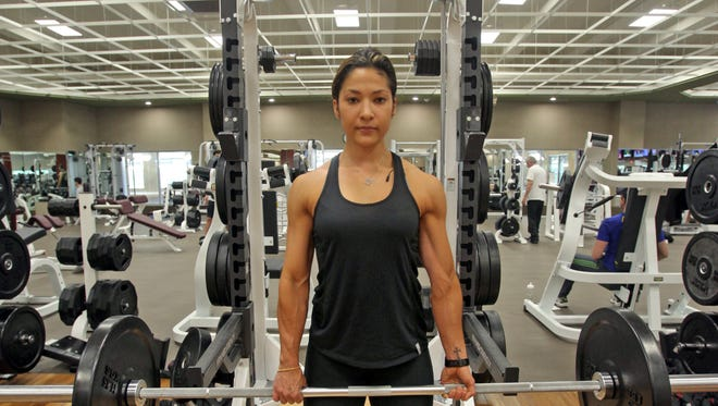 Personal trainer Robin Scott demonstrates how to do a deadlift with weights which focus on the full body work out at Lifetime Fitness in White Plains on April 30, 2014.