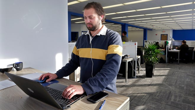"""""""People like to sit, and I like to stand. I have my own office over here,"""" said Kyle Kozera, who works at Business Development Pros in Bay View."""