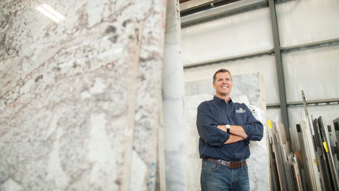 Brian Kauffman, owner of Renaissance Marble & Granite in Blackwood, stands by slabs of marble in Renaissance's warehouse. 09.11.14