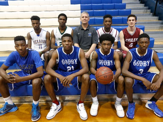The 2015 All-Big bend boys basketball first team. Front row, from left: Alex Perry (Maclay), Londell King (Godby), Jordan Gaskins (Godby), Quan Jackson (Godby); Back row, from left: Maurice Howard (Rickards), Dwight Wilson (Lincoln), Godby coach Andy Colville, Tajae Anderson (Florida High), Brett Easterling (Chiles)