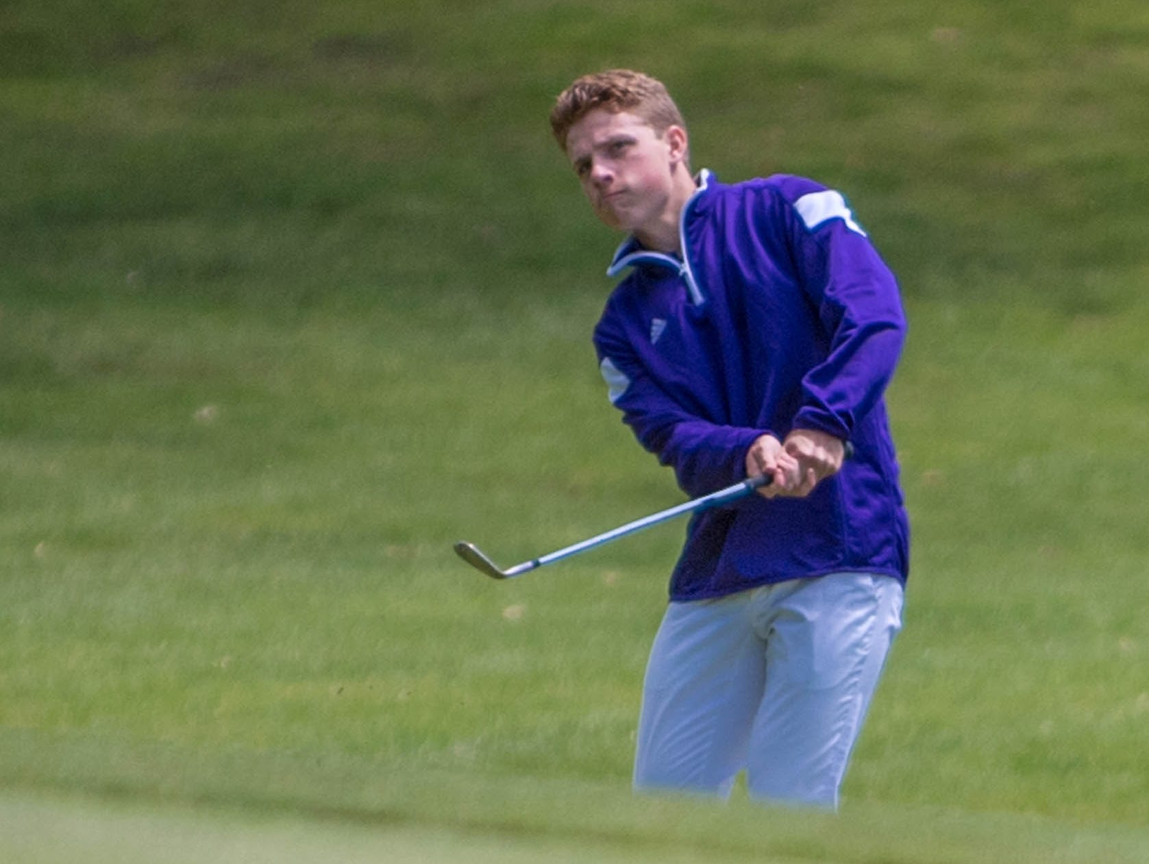 Lakeview junior James Staab chips to the green during All-City Golf Tournament at Riverside Golf Club on Friday.