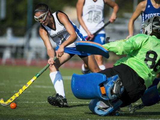 Cedar Crest's Emily Peters tries to find her way past Lampeter-Strasburg goalie Robin Feaster during the Falcons' 4-1 win on Tuesday afternoon. Peters scored the first goal in the win, Cedar Crest's first of the year.