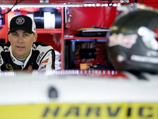 Kevin Harvick looks on from his garage during practice for the NASCAR Sprint Cup Series auto race at Chicagoland Speedway, Friday in Joliet, Ill.