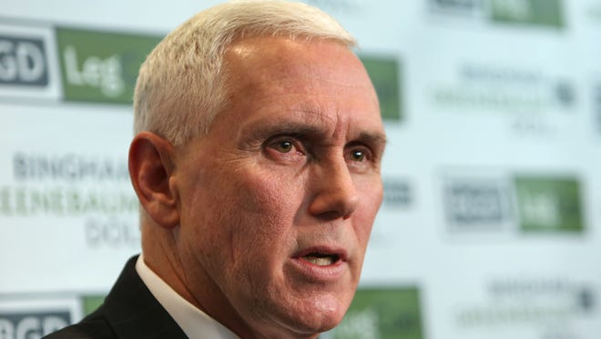 Gov. Mike Pence said Thursday that Indiana's tax revenue reduces the 2015 revenue projection by nearly 1 percent, but he said annual revenues are forecast to grow by 2.4 percent in 2016 and 3.2 percent in 2017. Pence is shown speaking to the media on Dec. 4, 2014, after unveiling his 2015 legislative agenda.