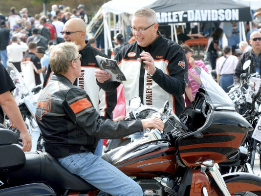 Harley-Davidson product engineer Pat Gwinn, right, talks to a visitor during last year's open house. This year's event starts Thursday.