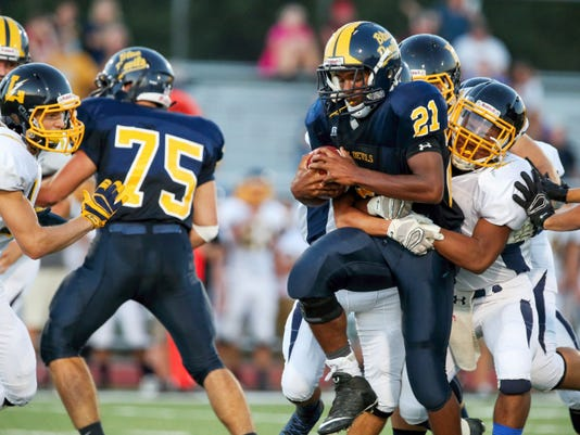 Greencastle-Antrim running back Demetrius Burton tries to break a tackle by a Littlestown defender. Burton ran for 189 yards and three touchdowns to help the Blue Devils to a 51-13 win Friday night. G-A's Sean Walck (75) makes a block ahead of the play.