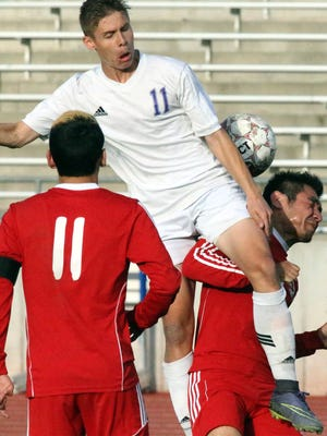 Sean Ryan, 11, of Eastlake leaps for a header against Jefferson Monday.