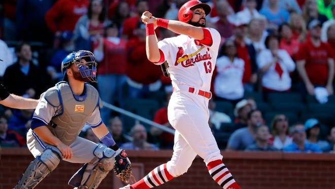 St. Louis Cardinals' Matt Carpenter, right, and Toronto Blue Jays catcher Russell Martin watch Carpenter's grand slam in the 11th inning to defeat the Blue Jays 8-4 in the first baseball game of a doubleheader Thursday, April 27, 2017, in St. Louis. (AP Photo/Jeff Roberson)