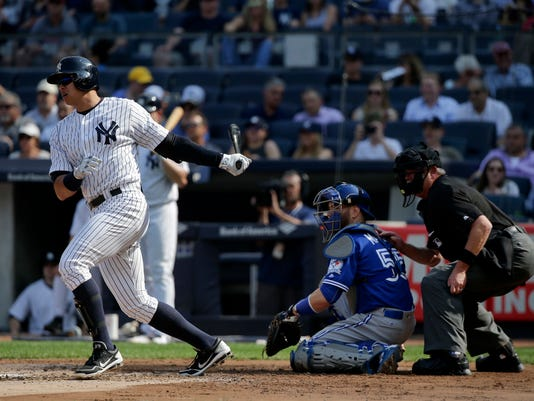 New York Yankees designated hitter Alex Rodriguez grounds out to the shortstop as Toronto Blue Jays catcher Russell Martin (55) looks on during the second inning of a baseball game, Thursday, May 26, 2016, in New York. (AP Photo/Julie Jacobson)