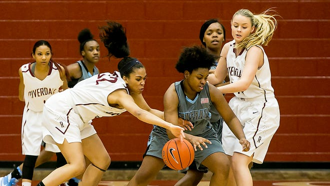 Riverdale's Brinae Alexander reaches in to make the steal for Lee-Huntsville's Samiayah Pullen.