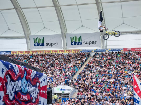 Nitro Circus Surfer thrills a crowd. The action sports