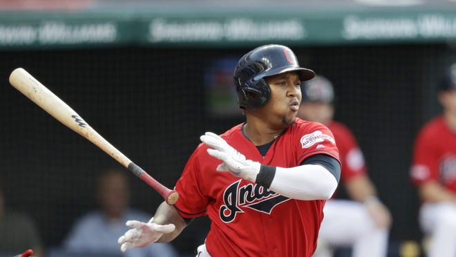 Cleveland Indians' Jose Ramirez watches an RBI double during the first inning of the team's baseball game against the Los Angeles Angels, Friday, Aug. 2, 2019, in Cleveland.