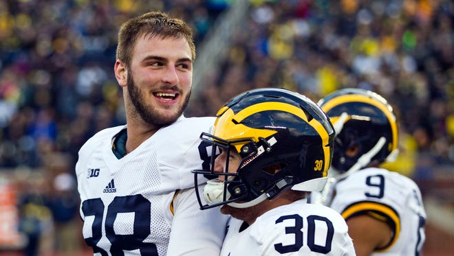 Michigan tight end Jake Butt, left, smiles during the spring game at Michigan Stadium in Ann Arbor on April 1, 2016.