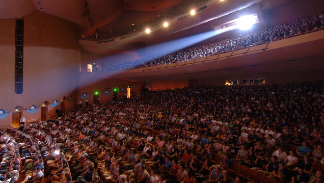 The audience enjoys a performance at ASU Gammage in Tempe.