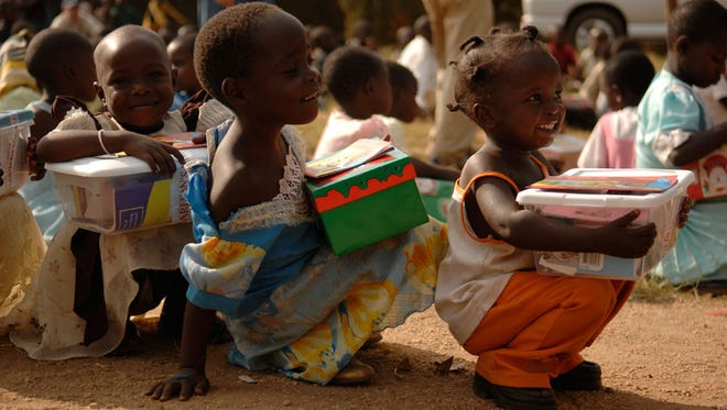 Children in Uganda receive shoeboxes from Operation Christmas Child.