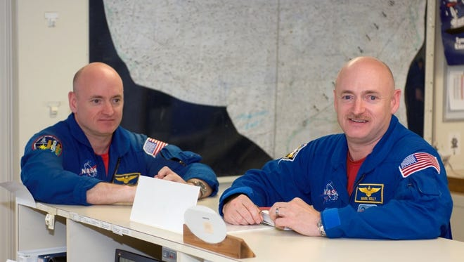 U.S. astronaut Scott Kelly and former astronaut Mark Kelly.