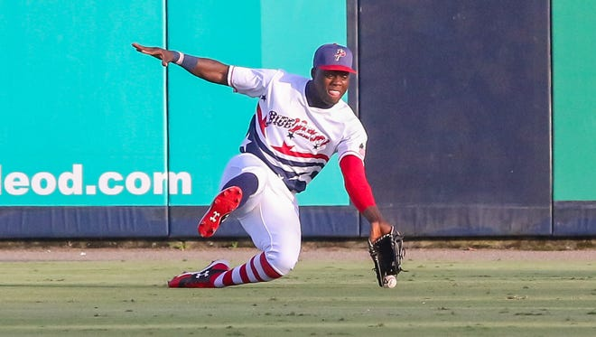Pensacola right fielder Aristides Aquino (6) tries to make a sliding catch against the Montgomery Biscuits on Monday, July 3, 2017.