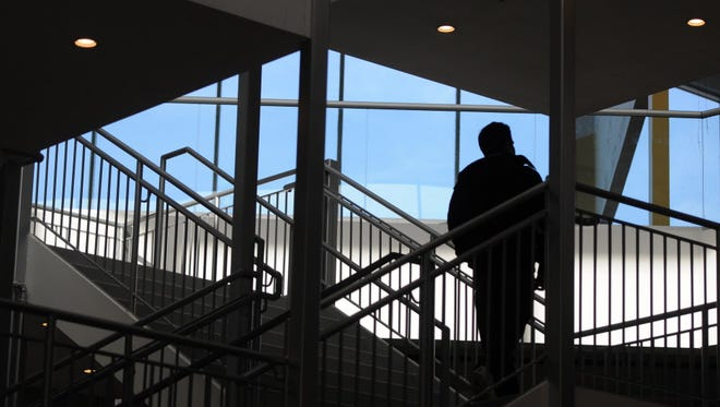 A man walks up the stairs at Center City Mall.