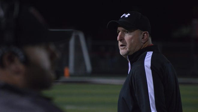 Harding football coach John Brady walks the sidelines during last week's 28-21 win over River Valley. The Presidents hold slim playoff hopes for next week.