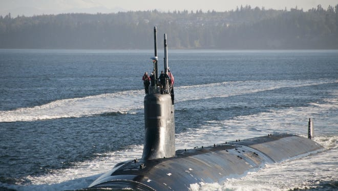 The Seawolf-class fast-attack submarine USS Jimmy Carter transits the Hood Canal as the boat returns home to Naval Base Kitsap-Bangor in September 2017.