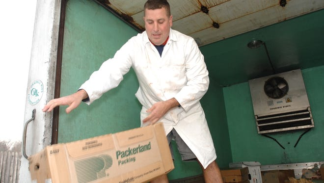 In this 2006 file photo, Christopher Lubben unloads fresh lamb and other meats for delivery to a local restaurant.