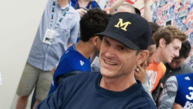 Jim Harbaugh attends the Sound Mind Sound Body football camp June 12, 2015, at Macomb Dakota High School.