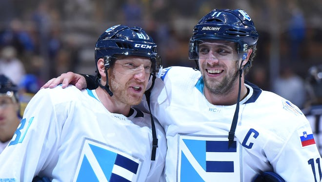 Team Europe forwards Marian Hossa and Anze Kopitar celebrate after a win over Sweden.