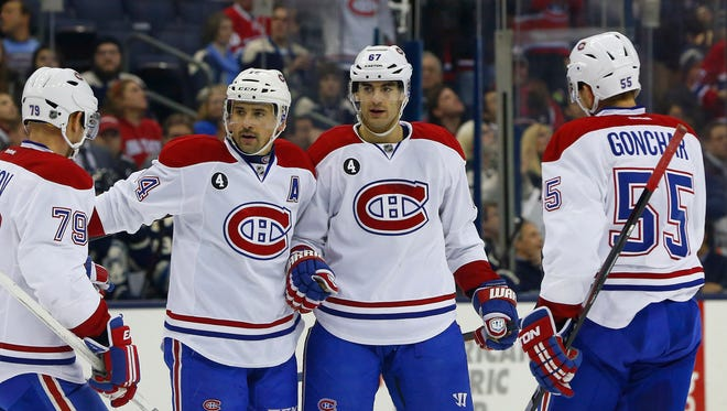Canadiens left wing Max Pacioretty, right, celebrates a goal against the Blue Jackets.