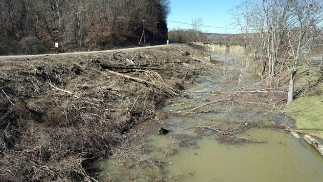 Contractors have begun removing trees in the former power plant canal in Philo in preparation for the construction of the new Philo bridge.