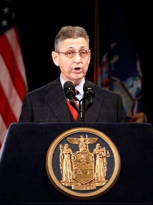 In this file photo, Assembly Speaker Sheldon Silver speaks during New York Gov. Andrew Cuomo's first State of the State address at the Empire State Plaza Convention Center in Albany, N.Y. Silver, who has been one of the most powerful men in Albany for more than two decades, was arrested today on public corruption charges.