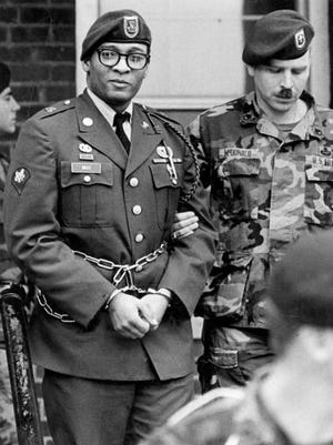 FILE - In this April 6, 1988, file photo, Ronald Gray leaves a courtroom escorted by military police at Fort Bragg, N.C. A Kansas federal judge has lifted a stay of execution for Gray, a former soldier who was sentenced to death for killing two women and a series of rapes, moving him closer to becoming the military's first death sentence carried out in more than a half century. No known execution date has been set for Gray as of Tuesday, Dec. 27, 2016.