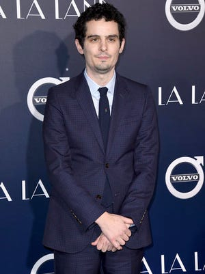 """FILE - This Dec. 6, 2016 file photo shows director Damien Chazelle at the premiere of """"La La Land"""" in Los Angeles. At the center of this year's Oscars are two filmmakers in their 30s with seemingly limitless careers ahead of them.  Barry Jenkins, the 37-year-old director of """"Moonlight,"""" and Chazelle, the 32-year-old maker of """"La La Land."""" Both films have 22 nominations between them."""