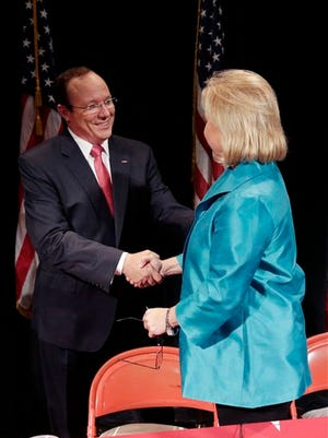 Sen. Mary Landrieu, D-La., greets Republican Senate candidate Rob Maness , left, before their debate at Centenary College.