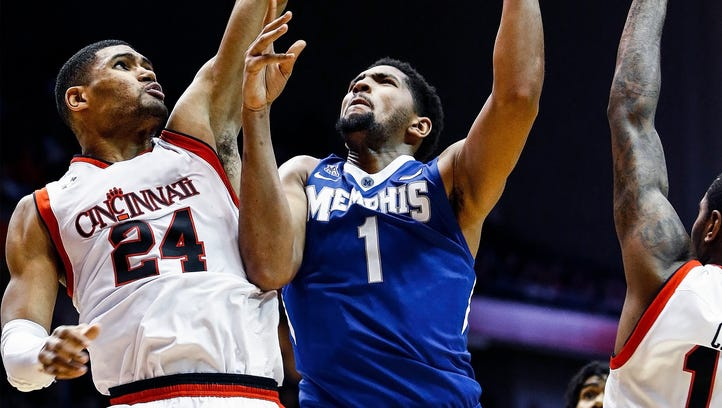 University of Memphis forward Dedric Lawson (middle)