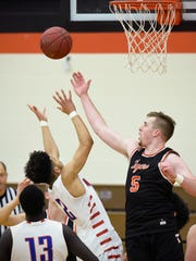 St. Cloud Tech's Kail Lindgren, 5, blocks a shot by St. Cloud Apollo's Marquise Smith during the second half Tuesday, Jan. 30, at Technical High School.