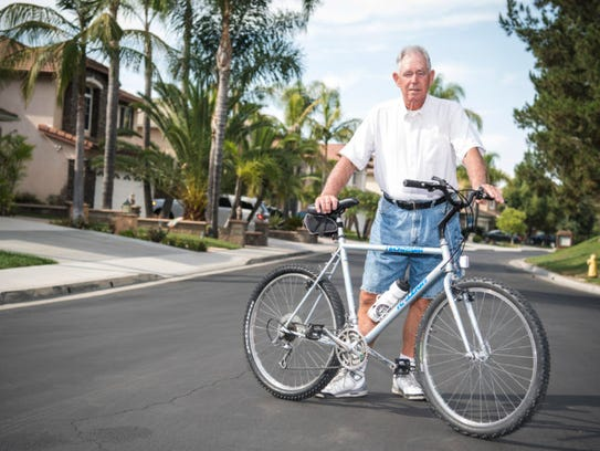 Tom Chudzinski with his bike on the residential street