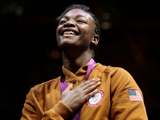 Claressa Shields of the United States participates in the medals ceremony after their women's final middleweight 75-kg gold medal boxing match at the 2012 Summer Olympics in London.