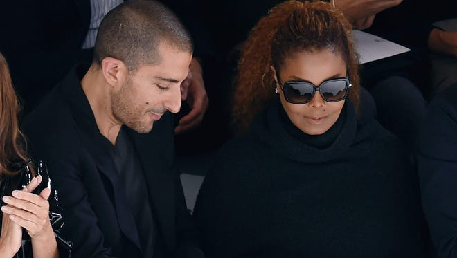 Singer Janet Jackson and her third husband, Qatari billionaire Wissam Al Mana, attend a fashion show last year in Paris. Their breakup comes just months after the birth of a son. Control issues are rumored to have a role.